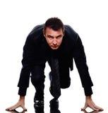 Business man silhouette on starting block Stock Photo