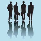 Business man silhouettes Stock Photography