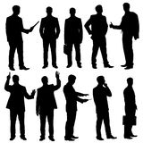 Business man silhouettes Stock Photos