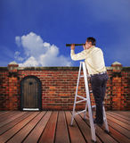 Business man and single spying telescope lens looking for target Royalty Free Stock Photo