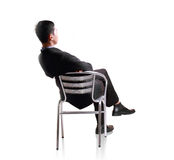 Business man sit down in single chair Stock Photography