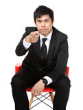 Business man sit and point to you Royalty Free Stock Photography