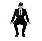 Business man sit on something Stock Image