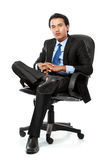 Business man sits on office chair Stock Images