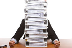 Business man sits beside paperwork folders Stock Image