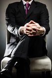 Business Man Sitting. Image of a business man sitting on chair Royalty Free Stock Images