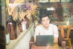 Business man sitting in art coffee shop using laptop computer Stock Photos