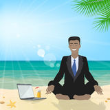 Business man sitting on the beach meditating in the lotus positi Stock Photography