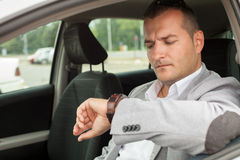 Business man sitting in a car Stock Photos