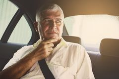 Business man sitting in car. stock photo