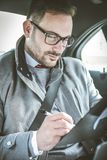 Working in car. royalty free stock photography
