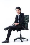 Business man sitting in chair Stock Images