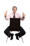 Business man sitting on a chair Royalty Free Stock Photography
