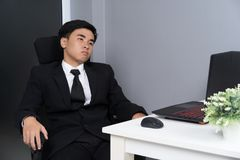 Business man sitting on chair and thinking Royalty Free Stock Photos
