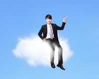 Business man sitting on a cloud Royalty Free Stock Photography
