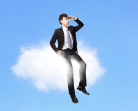 Business man sitting on a cloud Stock Image