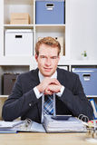 Business man sitting at desk Stock Photos
