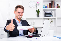 Business man sitting with document in office Stock Photography