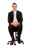 Business man sitting down Stock Images