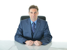 Business man sitting down. Business man sitting in executive chair looking forward Royalty Free Stock Photos