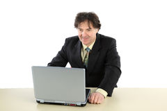 Business man sitting in front of his computer and working royalty free stock photo