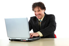 Business man sitting in front of his computer and working Stock Photos