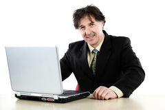Business man sitting in front of his computer and working Stock Images