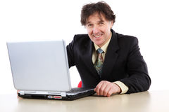 Business man sitting in front of his computer and working royalty free stock photography