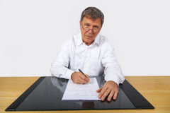 Business man sitting at his desk Stock Photography