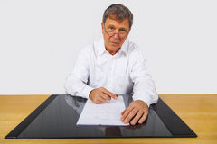 Business man sitting at his desk Stock Photo