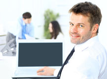 Business man sitting at his desk in the office Royalty Free Stock Photos