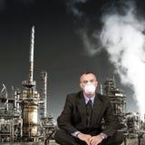 Man sitting near rafinery Royalty Free Stock Photos