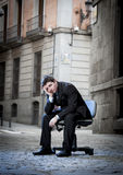 Business Man sitting on Office Chair on Street in stress Royalty Free Stock Image