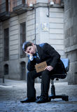 Business Man sitting on Office Chair on Street in stress Stock Photography