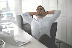 Business man sitting in office and stretched. Business man havin. G break. Portrait Royalty Free Stock Image