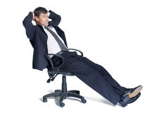 Business man sitting relaxed on a chair over white Royalty Free Stock Photo