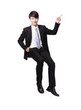 Business man sitting on some thing and show copy space Stock Image