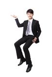 Business man sitting on some thing and show copy space Royalty Free Stock Image