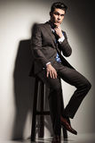 Business man sitting on a stool Royalty Free Stock Photos