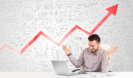 Business man sitting at table with market diagrams Stock Photo