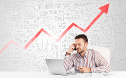 Business man sitting at table with market diagrams Stock Photos