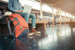 Business man sitting with using laptop. travel bag at the train Stock Photo