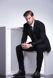 Business man sitting on a white table Stock Image