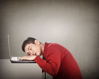 Business man sleeping in front of his laptop. Overwork concept Royalty Free Stock Image