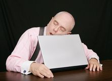Business man sleeping on his laptop Royalty Free Stock Photos