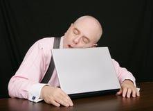 Business man sleeping on his laptop Royalty Free Stock Photos
