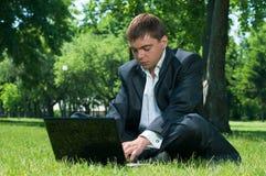 Business man sleeping on the job at a laptop Royalty Free Stock Photos