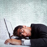Business man sleeping on a laptop computer Royalty Free Stock Photos