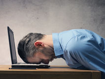 Business man sleeping on laptop Stock Images
