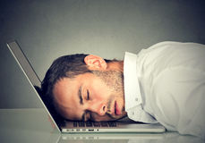 Business man sleeping on laptop in office Royalty Free Stock Photos